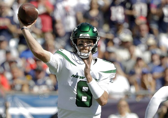 New York Jets quarterback Luke Falk passes against the New England Patriots in the first half of an NFL football game, Sunday, Sept. 22, 2019, in Foxborough, Mass. (AP Photo/Steven Senne)