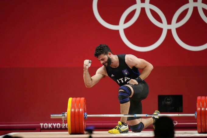 Antonino Pizzolato of Italy gestures after an unsuccessful lift in the men's 81kg weightlifting event, at the 2020 Summer Olympics, Saturday, July 31, 2021, in Tokyo, Japan. (AP Photo/Luca Bruno)