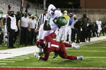 Oregon tight end DJ Johnson, top, dives for a touchdown while pressured by Washington State defensive back Tyrese Ross during the first half of an NCAA college football game in Pullman, Wash., Saturday, Nov. 14, 2020. (AP Photo/Young Kwak)