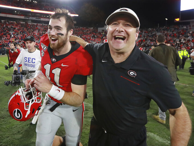 Georgia head coach Kirby Smart and quarterback Jake Fromm celebrate beating Texas A&M 19-13 in an NCAA college football game Saturday, Nov. 23, 2019, in Athens, Ga. (Curtis Compton/Atlanta Journal-Constitution via AP)