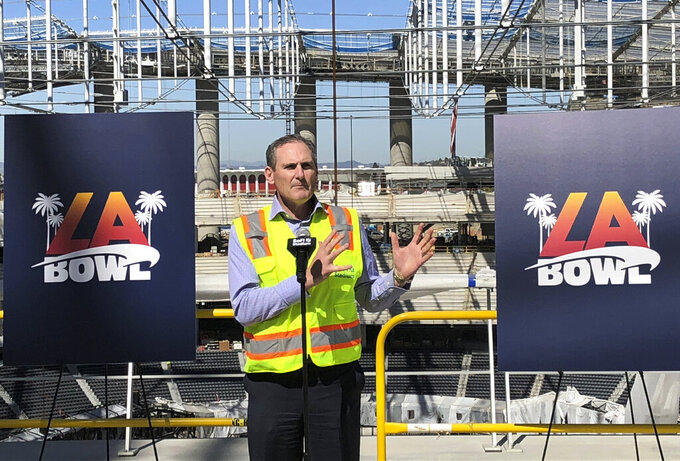 Pac-12 Commissioner Larry Scott speaks Wednesday, Feb. 26, 2020, about the new college football bowl game to be held at SoFi Stadium in Inglewood, Calif. The LA Bowl will match opponents from the Pac-12 and Mountain West conferences in December at the multibillion-dollar stadium, which is scheduled to open in July. (AP Photo/Greg Beacham)