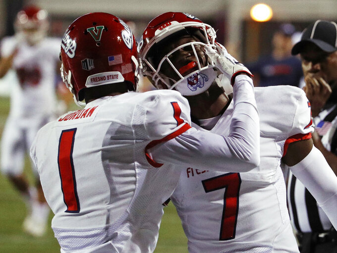 Fresno State wide receiver Jamire Jordan (1) celebrates after wide receiver Derrion Grim (7) scored against UNLV during the second half of an NCAA college football game Saturday, Nov. 3, 2018, in Las Vegas. (AP Photo/John Locher)