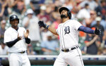 Detroit Tigers' Jeimer Candelario celebrates his two-run home run against the Minnesota Twins that also scored Jonathan Schoop, left, during the seventh inning of a baseball game Sunday, July 18, 2021, in Detroit. (AP Photo/Duane Burleson)