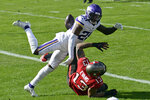 Minnesota Vikings cornerback Jeff Gladney (20) knocks the ball away from Tampa Bay Buccaneers wide receiver Mike Evans (13) during the first half of an NFL football game Sunday, Dec. 13, 2020, in Tampa, Fla. Gladney was called for a penalty on the play. (AP Photo/Jason Behnken)