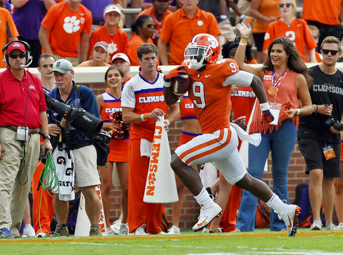 Clemson's Travis Etienne races down the sideline for a 40-yard touchdown during the second half of an NCAA college football game against Georgia Southern Saturday, Sept. 15, 2018, in Clemson, S.C. Clemson won 38-7. (AP Photo/Richard Shiro)