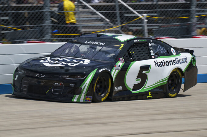 Kyle Larson rounds the track during a NASCAR Cup Series auto race at Dover International Speedway, Sunday, May 16, 2021, in Dover, Del. (AP Photo/Chris Szagola)