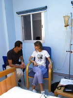 This photo posted Wednesday, Aug 8, 2018 on the official Facebook page of the Syrian Presidency, shows Syrian President Bashar Assad sitting next to his wife Asma Assad with an IV in her left arm in what appears to be a hospital room, in Syria. Syria's presidency said that the first lady has begun treatment for breast cancer. The statement said the