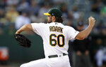 Oakland Athletics pitcher Tanner Roark works against the New York Yankees in the first inning of a baseball game Thursday, Aug. 22, 2019, in Oakland, Calif. (AP Photo/Ben Margot)