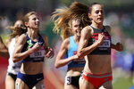 Jenny Simpson, right, wins the first heat in the prelims of women's 1500-meter run at the U.S. Olympic Track and Field Trials Friday, June 18, 2021, in Eugene, Ore. (AP Photo/Ashley Landis)