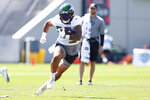 New York Jets running back Ty Johnson (25) runs a drill during practice at the team's NFL football training facility, Saturday, July. 31, 2021, in Florham Park, N.J. (AP Photo/Rich Schultz)