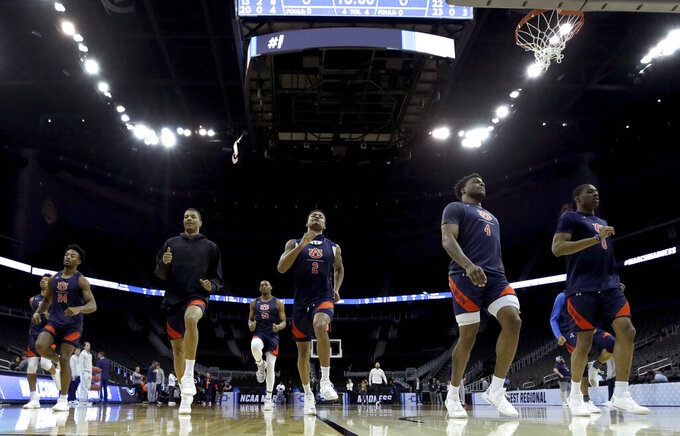 Auburn players warm up during practice at the NCAA men's college basketball tournament Thursday, March 28, 2019, in Kansas City, Mo. Auburn plays North Carolina in a Midwest Regional semifinal on Friday. (AP Photo/Charlie Riedel)