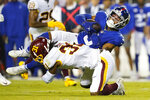 New York Giants wide receiver Sterling Shepard (3) is tackled by Washington Football Team safety Kamren Curl (31) during the second half of an NFL football game, Thursday, Sept. 16, 2021, in Landover, Md. (AP Photo/Patrick Semansky)