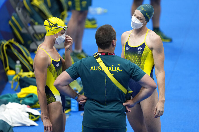 Australia swimmers Bronte Campbell, left, and Cate Campbell waiting to exercise during a swimming training session at the Tokyo Aquatics Centre at the 2020 Summer Olympics, Wednesday, July 21, 2021, in Tokyo, Japan. (AP Photo/Martin Meissner)