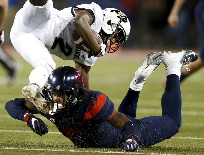 Arizona's Christian Young (5) makes a shoestring tackle of Colorado's Ronnie Blackmon (2) on a kickoff return during the second quarter of an NCAA college football game Friday, Nov. 2, 2018, in Tucson, Ariz. (Kelly Presnell/Arizona Daily Star via AP)
