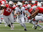 Ohio State defensive lineman Davon Hamilton, left, defensive lineman Taron Vincent, second from right, and defensive end Chase Young, right, put the pressure on Penn State quarterback Sean Clifford during the first half of an NCAA college football game Saturday, Nov. 23, 2019, in Columbus, Ohio. (AP Photo/Jay LaPrete)