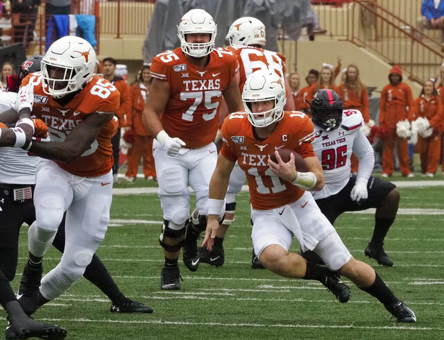 Texas quarterback Sam Ehlinger (11) runs the ball during the first half of an NCAA college football game against Texas Tech, Friday, Nov. 29, 2019, in Austin, Texas. (AP Photo/Michael Thomas)