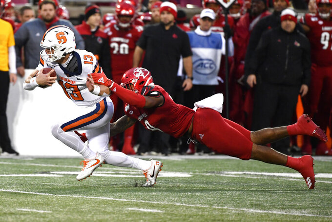 Syracuse quarterback Tommy DeVito (13) is brought down by Louisville linebacker C.J. Avery (9) during the first half of an NCAA college football game in Louisville, Ky., Saturday, Nov. 23, 2019. (AP Photo/Timothy D. Easley)