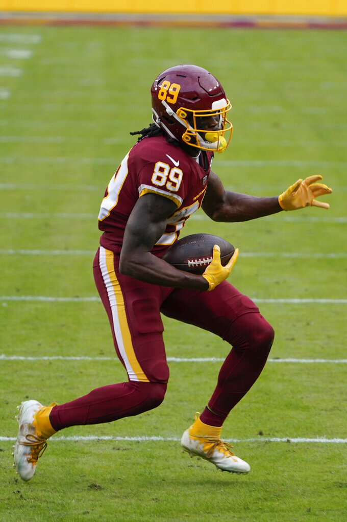 Washington Football Team wide receiver Cam Sims (89) runs with the ball during the second half of an NFL football game against the Seattle Seahawks, Sunday, Dec. 20, 2020, in Landover, Md. (AP Photo/Susan Walsh)