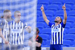 Brighton's Neal Maupay, right, celebrates after scoring his side's second goal during the English Premier League soccer match between Brighton & Hove Albion and Arsenal at the AMEX Stadium in Brighton, England, Saturday, June 20, 2020. (Mike Hewitt/Pool via AP)