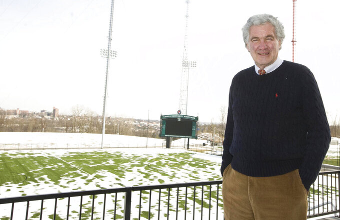 Loyola University athletic director Joe Boylan poses for a portrait at the school's new $62 million Ridley Intercollegiate Athletic Complex, in Baltimore. Boylan, a popular radio voice for Rutgers basketball and a former coach when the team made its only Final Four appearance nearly a half-century ago, died Sunday, March 21, 2021. He was 82. (Sarah Pastrana/The Baltimore Sun via AP)