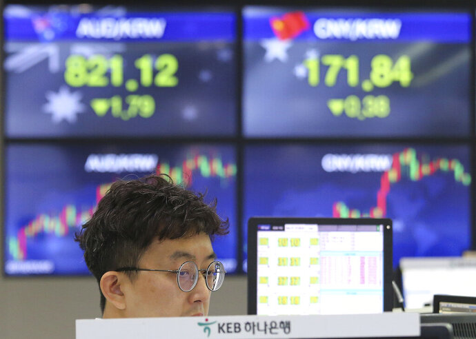A currency trader watches monitors at the foreign exchange dealing room of the KEB Hana Bank headquarters in Seoul, South Korea, Monday, May 27, 2019. Shares were mixed early Monday in Asia in the absence of fresh news on the tariffs standoff between the U.S. and China. (AP Photo/Ahn Young-joon)
