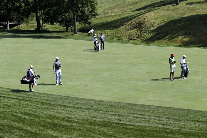 Nick Watney, Dylan Fritelli, of South Africa, and Denny McCarthy play during opening round of the Workday Charity Open golf tournament, Thursday, July 9, 2020, in Dublin, Ohio. (AP Photo/Darron Cummings)