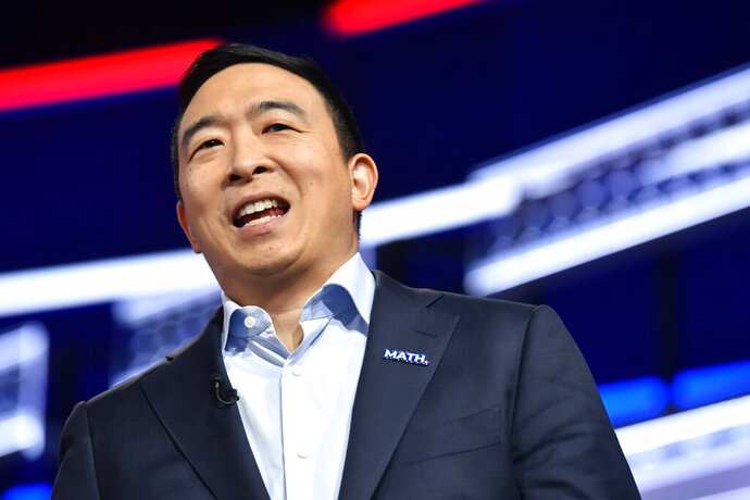 Democratic presidential candidate former technology executive Andrew Yang walks onto the stage before a Democratic presidential primary debate, Wednesday, Nov. 20, 2019, in Atlanta. (AP Photo/John Bazemore)