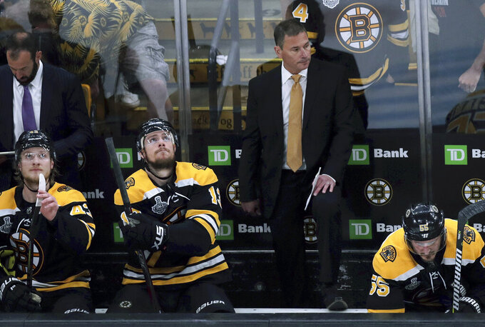 Boston Bruins head coach Bruce Cassidy watches from behind the bench during the first period in Game 7 of the NHL hockey Stanley Cup Final, Wednesday, June 12, 2019, in Boston. (AP Photo/Charles Krupa)
