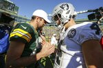 Green Bay Packers' Aaron Rodgers talks to Oakland Raiders' Derek Carr after an NFL football game Sunday, Oct. 20, 2019, in Green Bay, Wis. The Packers won 42-24. (AP Photo/Jeffrey Phelps)