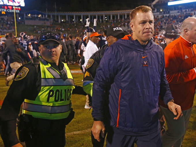 Virginia head coach Bronco Mendenhall heads to the locker room after an NCAA college football game in Charlottesville, Va., Saturday, Oct. 13, 2018. Virginia defeated Miami 16-13. (AP Photo/Steve Helber)
