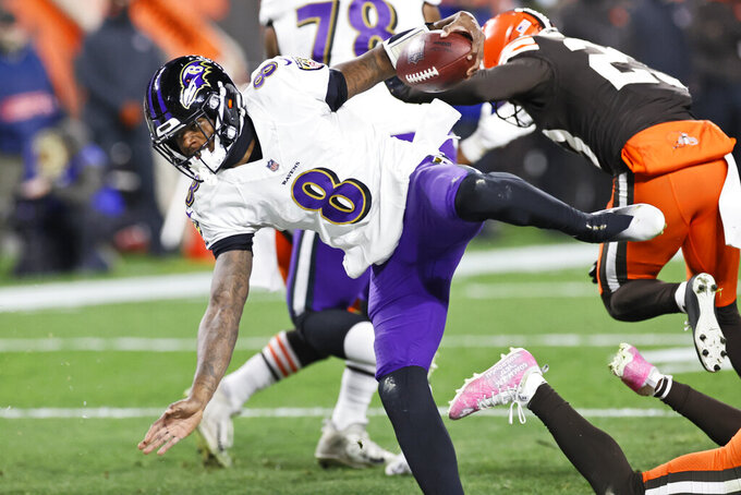 Baltimore Ravens quarterback Lamar Jackson (8) rushes for a 5-yard touchdown during the first half of an NFL football game against the Cleveland Browns, Monday, Dec. 14, 2020, in Cleveland. (AP Photo/Ron Schwane)