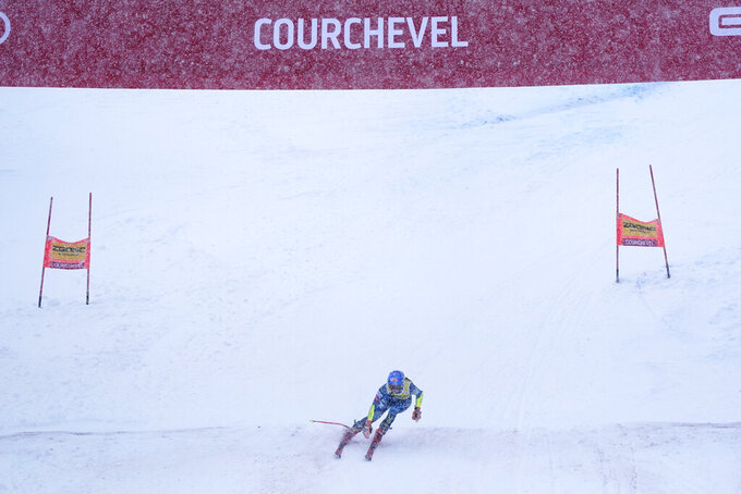 United States' Mikaela Shiffrin speeds down the course during an alpine ski, women's World Cup giant slalom in Courchevel, France, Saturday, Dec. 12, 2020. (AP Photo/Giovanni Auletta)