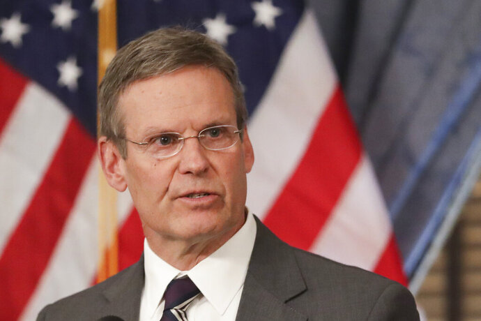 FILE - In this Monday, March 16, 2020, file photo, Tennessee Gov. Bill Lee answers questions concerning the state's response to the coronavirus during a news conference in Nashville, Tenn. Lee's