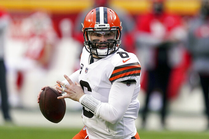 FILE - Cleveland Browns quarterback Baker Mayfield throws during the second half of an NFL divisional round football game against the Kansas City Chiefs in Kansas City, Mo., in this Sunday, Jan. 17, 2021, file photo. The Browns exercised the fifth-year option on quarterback Baker Mayfield's rookie contract, an expected move after his strong 2020 season. (AP Photo/Charlie Riedel, File)