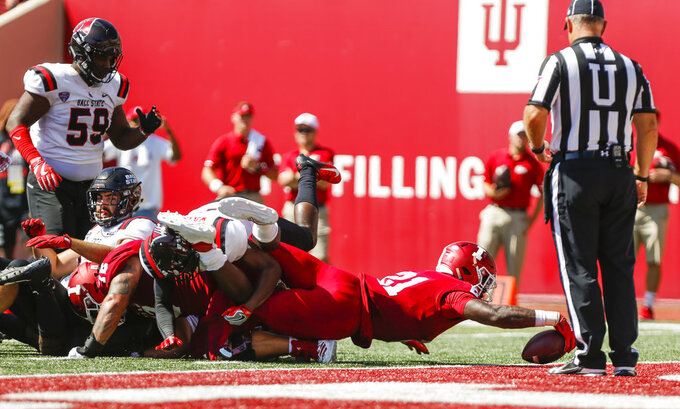 Indiana's Stevie Scott (21) carries the ball against Ball State during an NCAA college football game, Saturday, Sept. 15, 2018 in Bloomington, Ind. (Jeremy Hogan/The Herald-Times via AP)
