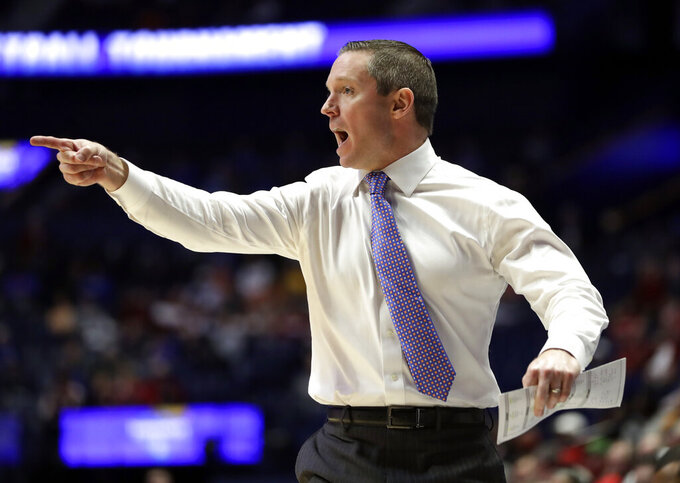 Florida head coach Mike White yells to his players in the first half of an NCAA college basketball game against Arkansas at the Southeastern Conference tournament Thursday, March 14, 2019, in Nashville, Tenn. (AP Photo/Mark Humphrey)