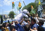 Pakistani Kashmiris carry an effigy of Indian Premier Narendra Modi during an anti-Indian protest in Muzaffarabad, capital of Pakistani Kashmir, Thursday, Aug. 8, 2019. Pakistan's federal minister for railways said Thursday that Islamabad has suspended a key train service with neighboring India over change in Kashmir's special status by New Delhi. (AP Photo/M.D. Mughal)