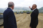 Azerbaijani President Ilham Aliyev, right, points an area to Turkey's President Recep Tayyip Erdogan, in Shusha, in Nagorno-Karabakh, Azerbaijan, Tuesday, June 15, 2021. Shusha, a culturally revered city that Azerbaijan liberated from Armenian forces in last autumn's war. Shusha, a center of Azerbaijani Turkish culture for centuries, came under Armenian control in 1992 in fighting over the separatist Nagorno-Karabakh region.(Turkish Presidency via AP, Pool)