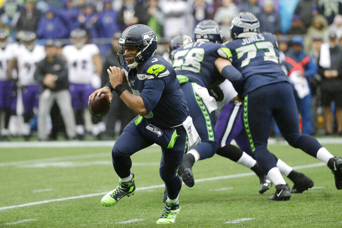 Seattle Seahawks quarterback Russell Wilson scrambles during the first half of an NFL football game against the Baltimore Ravens, Sunday, Oct. 20, 2019, in Seattle. (AP Photo/Elaine Thompson)
