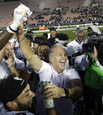 "FILE - In this Jan. 19, 2019, file photo, American Team head coach Chuck Pagano celebrates with his players after a 10-7 win over the National Team in the NFLPA Collegiate Bowl football game in Pasadena, Calif. Pagano is ready to embrace the ""opportunity of a lifetime"" as the Chicago Bears' new defensive coordinator. He inherits a group that ranked among the best in the NFL and helped Chicago win the NFC North after four straight last-place finishes. (AP Photo/Marcio Jose Sanchez, File)"