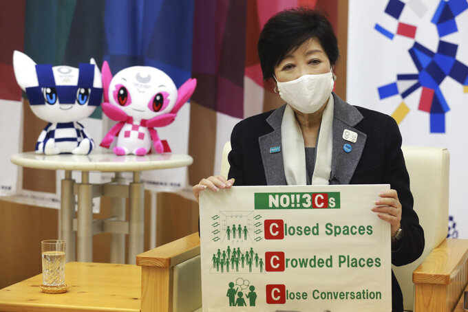 """Tokyo Gov. Yuriko Koike speaks during an interview with The Associated Press in Tokyo, Monday, Dec. 14, 2020. The growing availability of coronavirus vaccines is a """"ray of hope"""" for hosting the Olympics next summer, Koike said Monday as Japan struggles with a new surge in infections. (AP Photo/Koji Sasahara)"""