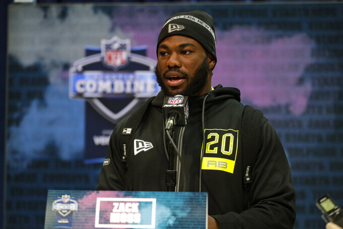 Utah running back Zack Moss speaks during a press conference at the NFL football scouting combine in Indianapolis, Wednesday, Feb. 26, 2020. (AP Photo/Michael Conroy)