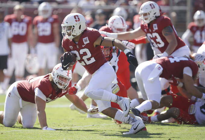 Stanford's Cameron Scarlett (22) rushed against Arizona during the first half of an NCAA college football game Saturday, Oct. 26, 2019, in Stanford, Calif. (AP Photo/Ben Margot)