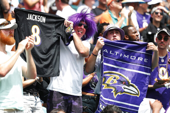 Baltimore Ravers cheer the team, during the first half at an NFL football game against the Miami Dolphins, Sunday, Sept. 8, 2019, in Miami Gardens, Fla. (AP Photo/Wilfredo Lee)
