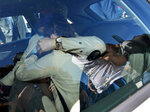 Amanda Knox hides her face from the cameras as she sits in a car after her arrival in Linate airport, Milan, Italy, Thursday, June 13, 2019. Knox has returned to Italy for the first time since she was convicted and imprisoned, but ultimately acquitted, for the murder and sexual assault of her British roommate Meredith Kercher in the university town of Perugia in 2007. Knox is in Italy to attend a conference in Modena organized by the Italy Innocence Project, which seeks to help people who have been convicted for crimes they did not commit. (Daniel Dal Zennaro/ANSA via AP)