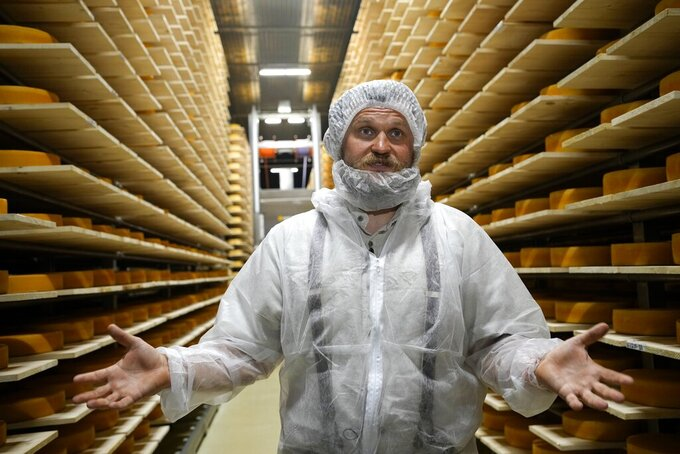 Russian cheese maker Oleg Sirota gestures during his interview with the Associated Press in Dubrovskoye village, in Istra district, 51 km. (31,8 miles) west of Moscow, Russia, Thursday, July 15, 2021. Thursday is the deadline the authorities set for eligible companies to ensure that 60% of their staff receive at least one shot of a vaccine. Sirota, founder of a cheese factory that has dozens of retail outlets in and around the Russian capital, said that as of Thursday, 70% of staff have received their shots, but the reluctance was difficult to overcome. (AP Photo/Alexander Zemlianichenko)