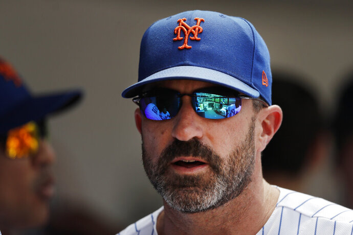 New York Mets manager Mickey Callaway watches from the dugout against the Miami Marlins in a baseball game, Wednesday, Aug. 7, 2019 in New York. (AP Photo/Mark Lennihan)