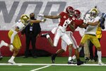 Alabama wide receiver DeVonta Smith (6) gets help against Notre Dame defenders from wide receiver John Metchie III (8) as Smith sprints to the end zone for a touchdown after making a catch in the first half of the Rose Bowl NCAA college football game in Arlington, Texas, Friday, Jan. 1, 2021. (AP Photo/Ron Jenkins)