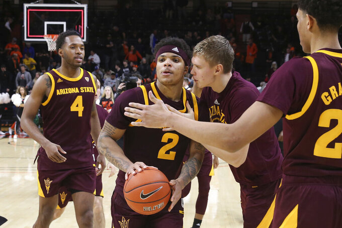 Arizona State's Rob Edwards (2) is congratulated by teammates after Arizona State defeated Oregon State 82-76 in an NCAA college basketball game in Corvallis, Ore., Thursday, Jan. 9, 2020. (AP Photo/Chris Pietsch)