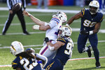 Buffalo Bills quarterback Josh Allen (17) is sacked by Los Angeles Chargers defensive end Joey Bosa (97) during the first half of an NFL football game, Sunday, Nov. 29, 2020, in Orchard Park, N.Y. (AP Photo/Adrian Kraus)